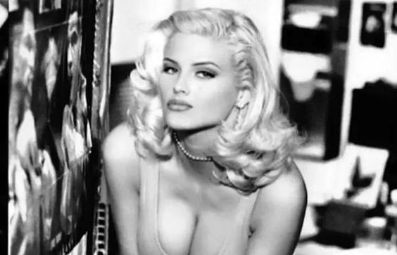 Anna Nicole Smith poses in an early Guess campaign